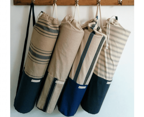Yoga bags made with upcycled cotton hanging on hook