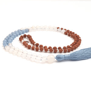 Handmade Angelite Quartz and Rudraksha Mala curled on table