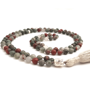 Handmade Bloodstone Empowering Mala curled on a table